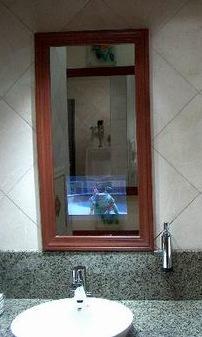 Multitasking, Harvard Square style: in-mirror televison