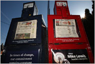 News boxes in Seattle. (NYT)